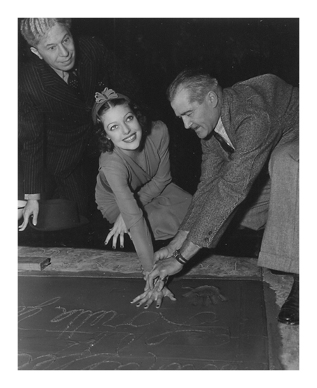 Loretta Young Puts Her Hand Prints in Concrete at Grauman's Chinese Theater