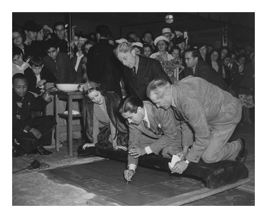 Loretta Young at Grauman's Chinese Theater with Sid Grauman and Tyrone Power